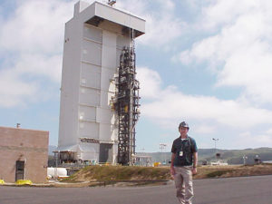 Dick Quinn stands in front of launch platform.